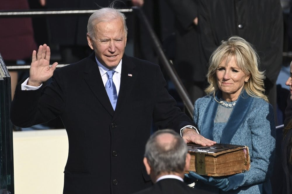 <p>Joe Biden is sworn in as the 46th president of the United States by Chief Justice John Roberts as Jill Biden holds the Bible during the 59th Presidential Inauguration at the U.S. Capitol in Washington, Wednesday, Jan. 20, 2021. (Saul Loeb/Pool Photo via AP)</p>