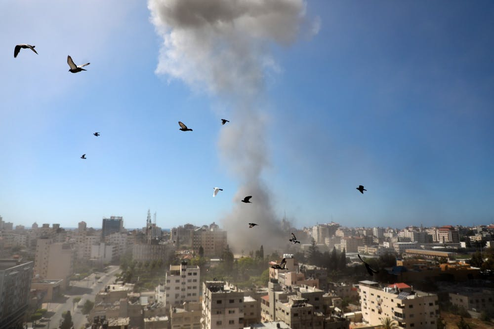 <p>A thick column of smoke rises from the Jala Tower as it is destroyed in an Israeli airstrike in Gaza City controlled by the Palestinian Hamas movement, on May 15, 2021. The ongoing Israeli attacks on the Gaza Strip have left dozens of people dead and more than 1,000 others injured. <strong>(Majdi Fathi/NurPhoto/Zuma Press/TNS)</strong></p>