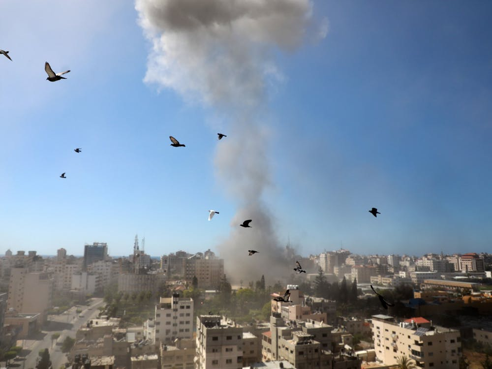 A thick column of smoke rises from the Jala Tower as it is destroyed in an Israeli airstrike in Gaza City controlled by the Palestinian Hamas movement, on May 15, 2021. The ongoing Israeli attacks on the Gaza Strip have left dozens of people dead and more than 1,000 others injured. (Majdi Fathi/NurPhoto/Zuma Press/TNS)