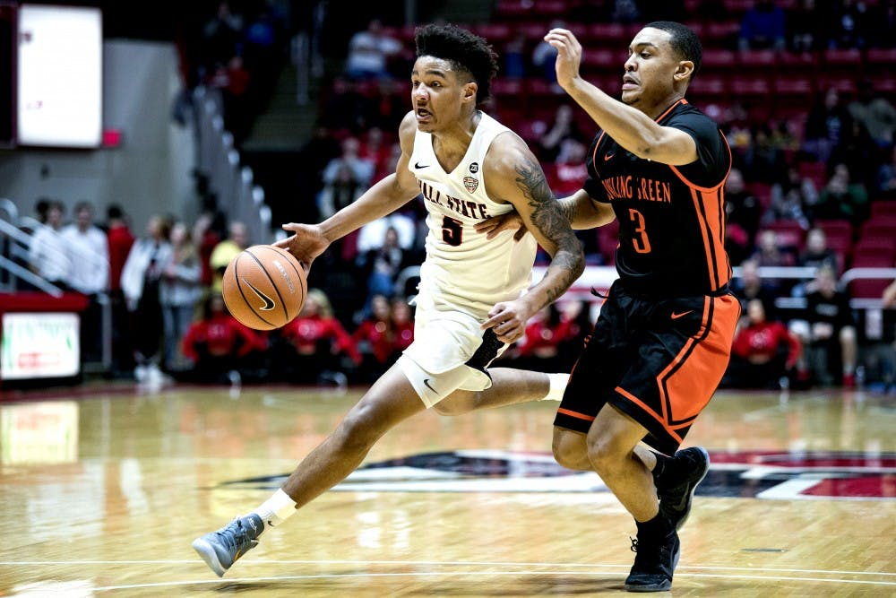 Freshman guard Ishmael El-Amin, pushes past Bowling Green's Rodrick Caldwell in the first half, Feb. 6 at John E. Worthen Arena. The team reached the Sweet 16 in 1990 before falling to eventual National Champion UNLV. Grace Hollars, DN