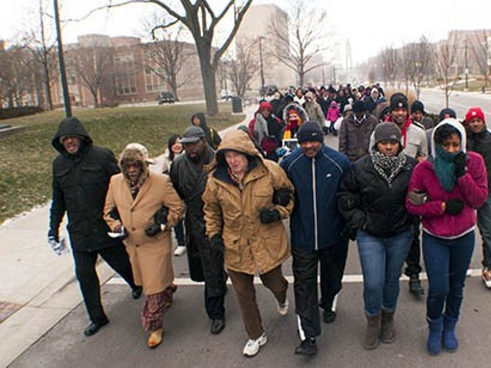 Participants of the Unity March walk down McKinley Ave. on Monday in honor of Martlin Luther King, Jr. Day. Events to commemorate Dr. King's vision will continue throughout the week as part of Unity Week. DN PHOTO BOBBY ELLIS