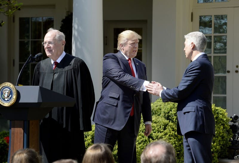 Justice Anthony Kennedy speaks as President Donald trump shakes hands with Neil Gorsuch ibefore a swearing in ceremony at the White House Rose Garden April 10, 2017 in Washington, D.C. (Olivier Douliery/Abaca Press/TNS)