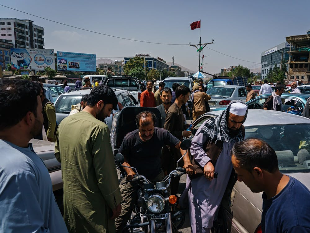 Pedestrians, motorists ended up in a traffic grid lock as the Afghans rush to safety with the uncertainty and rumor swirling that Taliban enter the city and take over, Kabul, Afghanistan, Sunday, Aug. 15, 2021. (Marcus Yam/Los Angeles Times/TNS)
