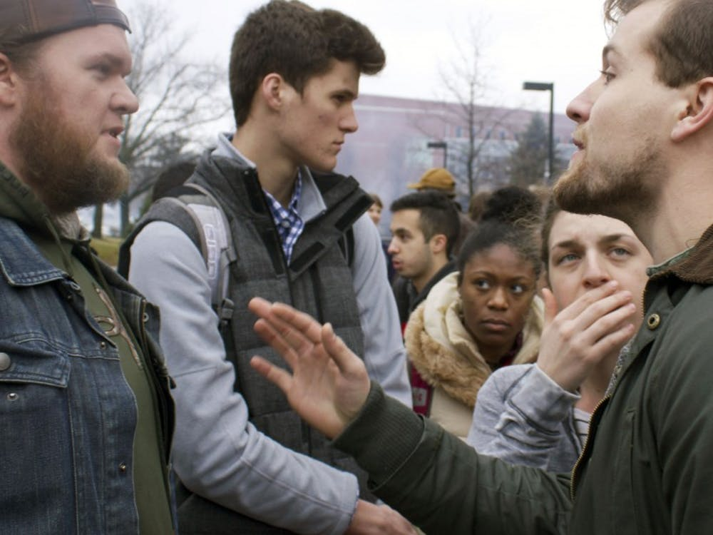 Wes Guthrie (left), a senior computer science major and Donald Trump supporter, argues with a Trump protestor after resistence rally to protest President Donald Trump on Jan. 20. The argument stayed peaceful, but went on for long after the rally finished. Kara Berg // DN