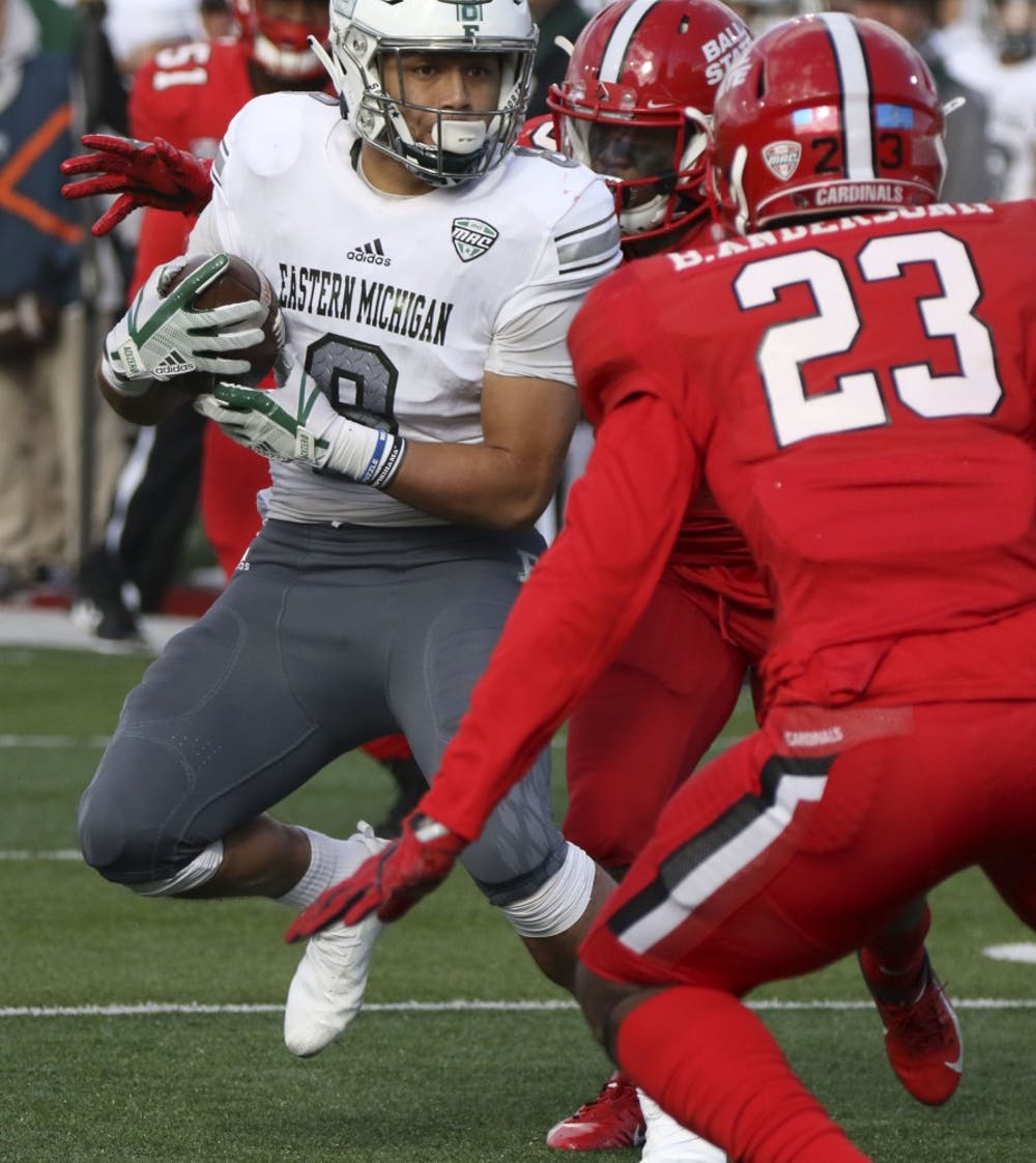 <p>Eastern Michigan's Line Latu tries to dodge Ball State sophomore safety Brett Anderson II during the Cardinals' game against the Eagles Oct. 20, 2018, at Scheumann Stadium. Ball State lost 42-20 on Homecoming. Paige Grider, DN</p>