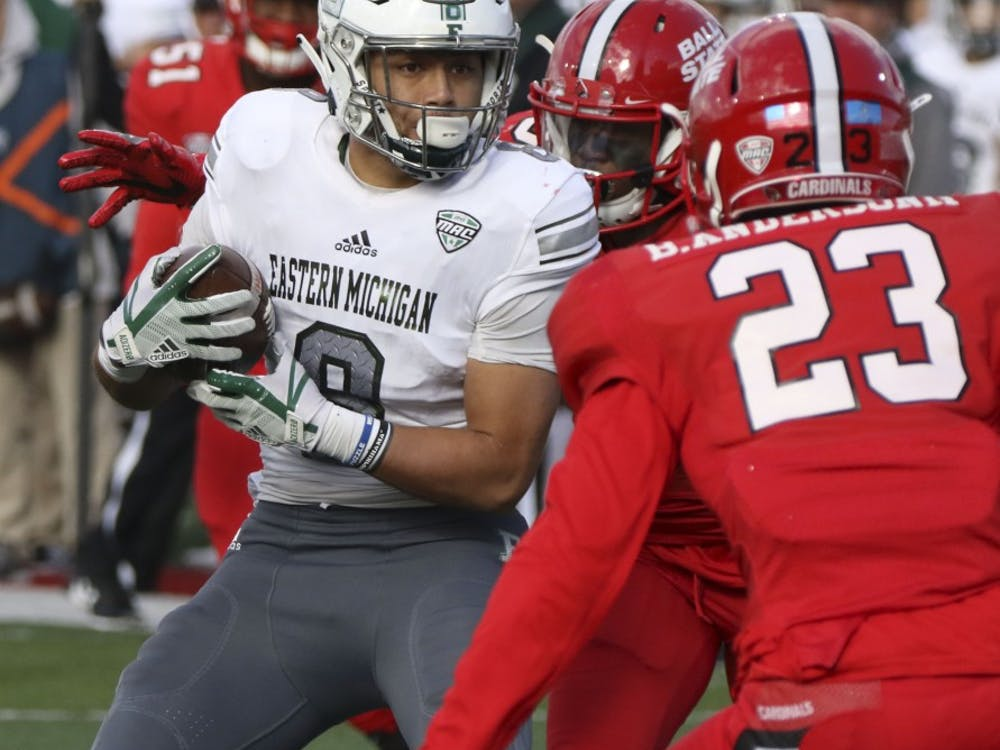 Eastern Michigan's Line Latu tries to dodge Ball State sophomore safety Brett Anderson II during the Cardinals' game against the Eagles Oct. 20, 2018, at Scheumann Stadium. Ball State lost 42-20 on Homecoming. Paige Grider, DN