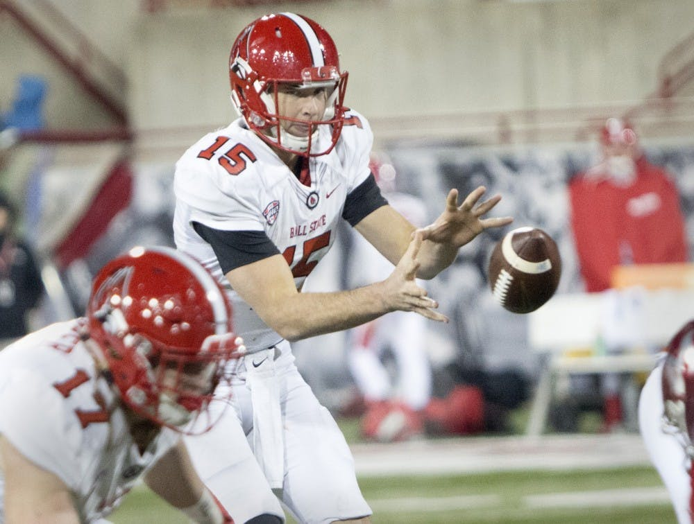 Quarter back, Riley Neal begins to search for a open receiver 10 yards from the end zone against the Miami Redhawks on Tuesday, November 22 at Yarger Stadium. (DN, Grace Hollars)