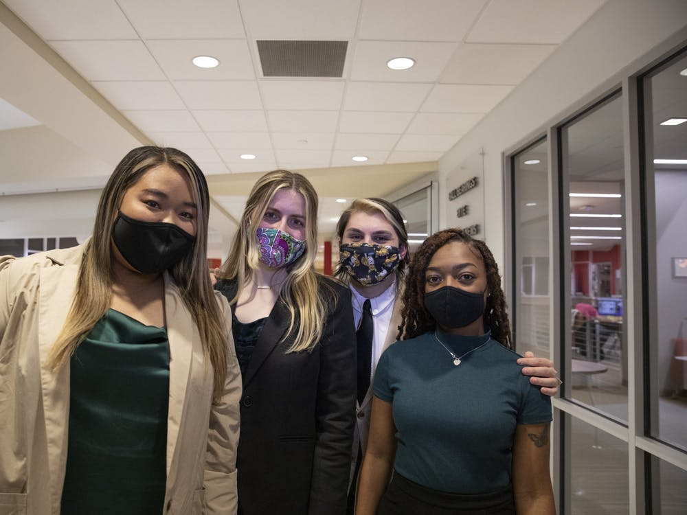 (From left to right) Tina Nguyen, Chiara Biddle, Jacob Bartolotta and Nita Burton of the Student Government Association (SGA) Strive slate stand together Feb. 10, 2021. Slate members were inaugurated into their respective positions of SGA president, vice president, treasurer and chief administrator April 21. Jacob Musselman, DN File