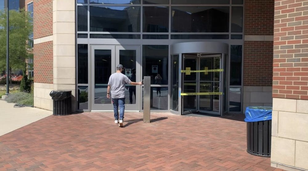 Ball State freshman Colin Williams keying into residence hall Johnson A after the Housing and Residence Life Office sent an email to students stating that they must swipe their ID before they enter the hall.