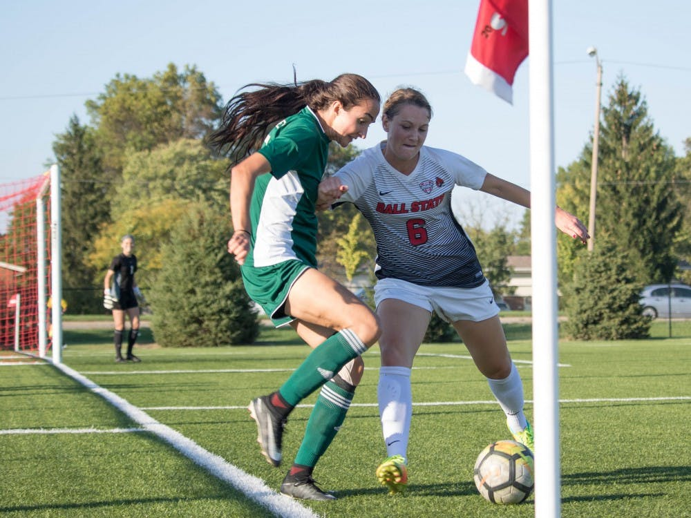 Senior midfielder Lucy Walton pushes against an Eastern Michigan University player a on Oct. 13 at Briner Sports Complex. Rebecca Slezak, DN