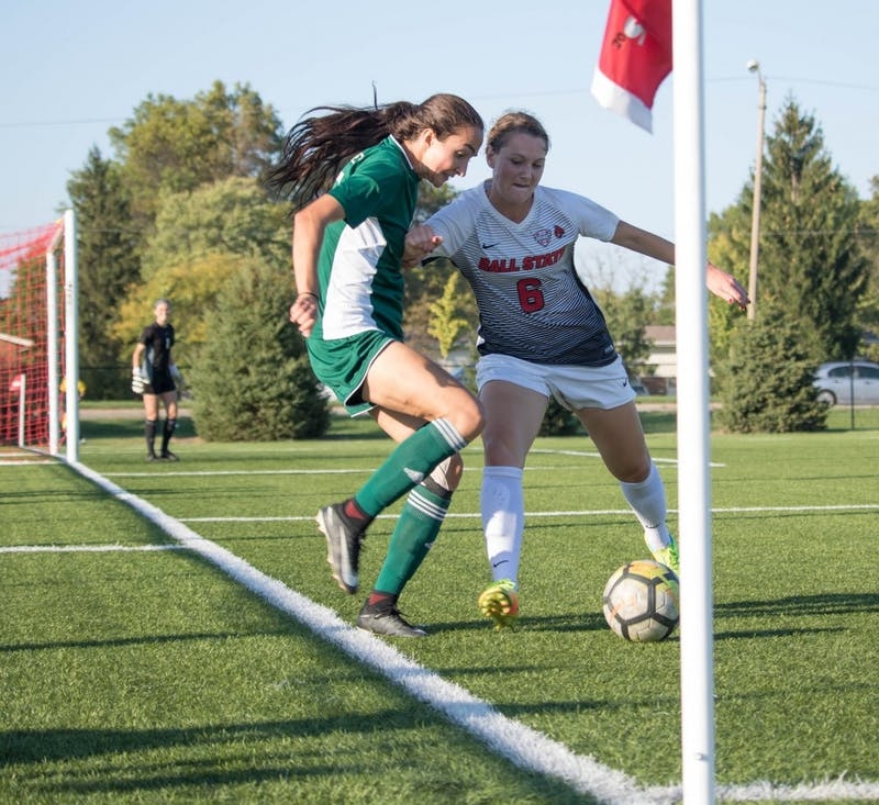 Senior midfielder Lucy Walton pushes against an Eastern Michigan University player a on Oct. 13 at Briner Sports Complex. Rebecca Slezak, DN