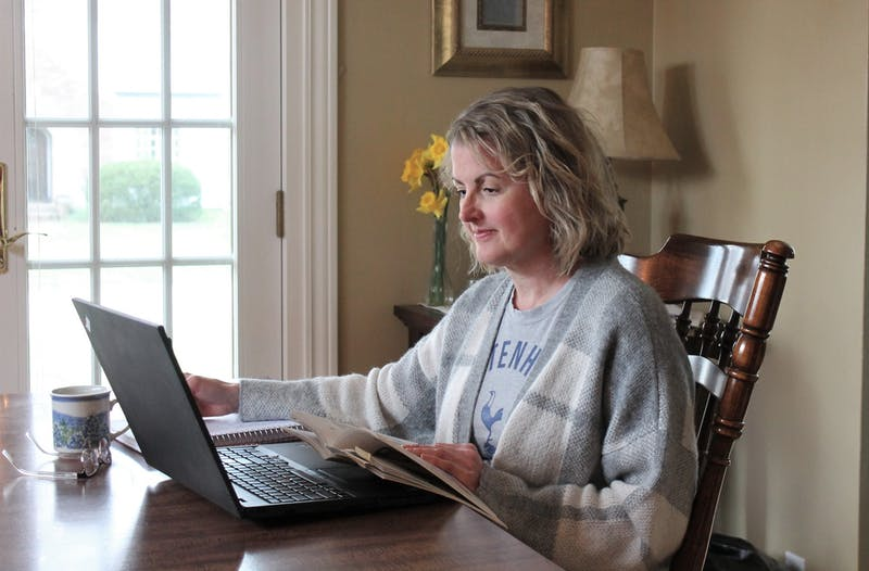 Pamela Hartman, associate professor of English, works on her laptop April 10, 2020, at her home. While there are some positives to online instruction, Hartman said it doesn't outweigh the stress it has caused both her and her students. Pamela Hartman, Photo Provided