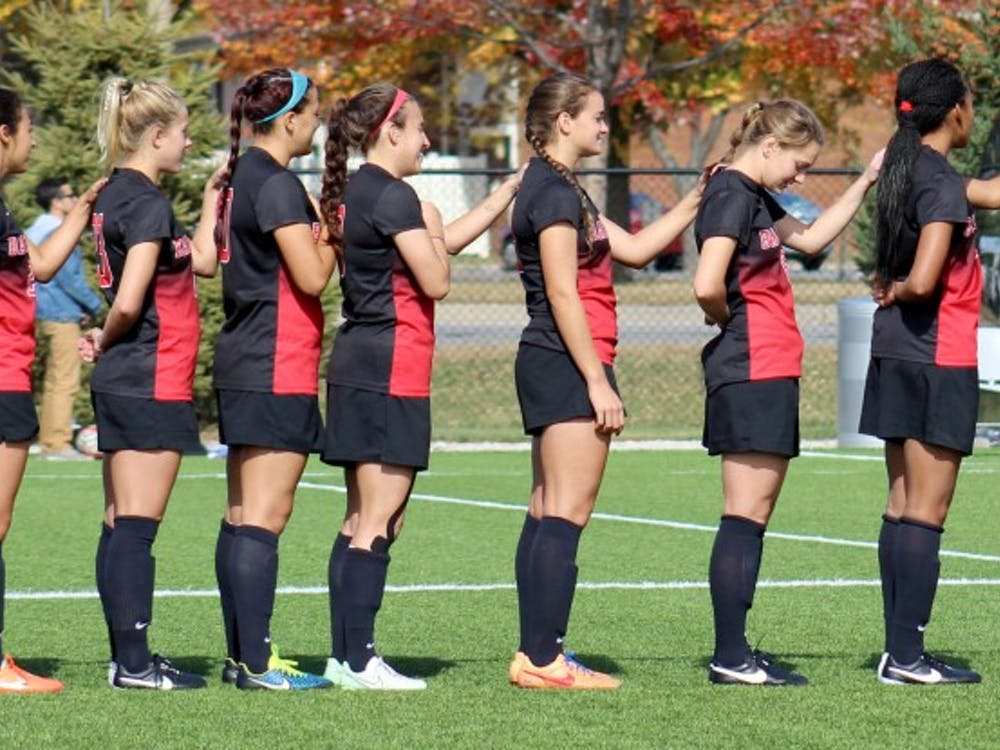 The Ball State Women's Soccer team lines up for the National Anthem before the match against Buffalo on Oct. 25 at the Briner Sports Complex. DN PHOTO ALLYE CLAYTON