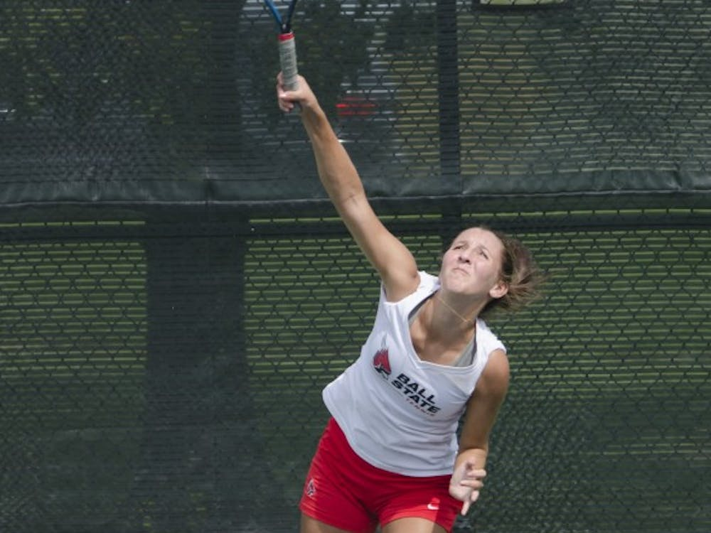 Sophomore Toni Ormond serves the ball during the doubles match against Butler for the Fall Dual on Sept. 20 at the Cardinal Creek Tennis Center. DN PHOTO BREANNA DAUGHERTY