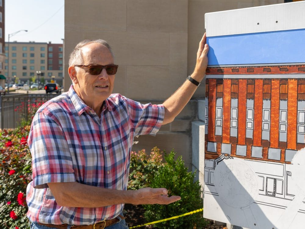 Robert Hartley with his work in progress traffic box art on Wednesday Aug. 22, in Muncie, IN. Hartley's traffic box can be found on the corner of West Charles Street and South High Street. Kyle Crawford, DN