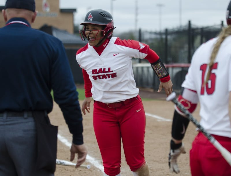 Freshman outfielder Kennedy Wynn walks off of the field after scoring during the second game of the double-header against Northern Illinois on April 4 at the Softball Field at the First Merchants Ballpark Complex. Ball State won the game 6-4. Emma Rogers // DN