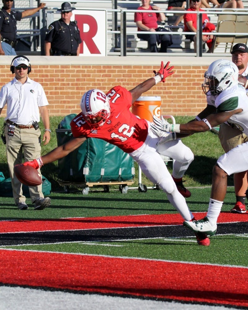 Ball State freshman wide receiver Justin Hall falls into the end zone with 8:26 remaining in the fourth quarter of the Cardinals' game against UAB on Sept. 9 at Scheumann Stadium. Hall's touchdown put Ball State up 51-24. Paige Grider, DN File