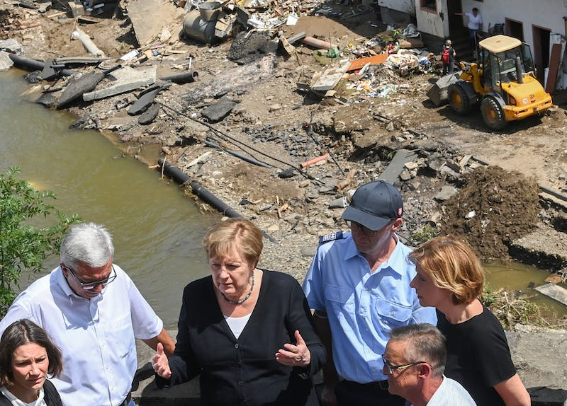 German Chancellor Angela Merkel (2ndL) and Rhineland-Palatinate State Premier Malu Dreyer (R) talk as they stand on a bridge during their visit in the flood-ravaged areas on July 18, 2021 in Schuld, near Bad Neuenahr-Ahrweiler, Rhineland-Palatinate state, western Germany. Extreme downpours caused devastating floods this week in Germany and other parts of western Europe devastating the region. The death toll across Germany and Belgium has risen to at least 180 as rescue workers continue their efforts and communities begin to clear the debris left by the receding waters. (Christof Stache-Pool/Getty Images/TNS)