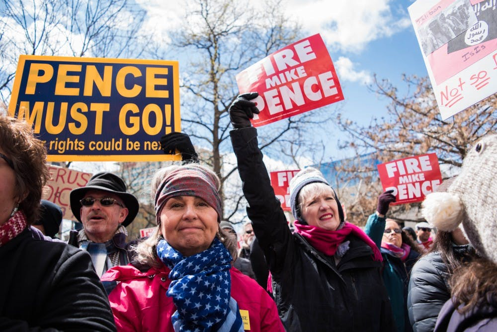 <p>Protesters filled the lawn of the Indiana Statehouse April 9 in opposition of the new abortion bill passed by&nbsp;Gov. Mike Pence. The bill, HB 1337, put stipulations in place for women who want to have an abortion. <em>DN PHOTO STEPHANIE AMADOR</em></p>