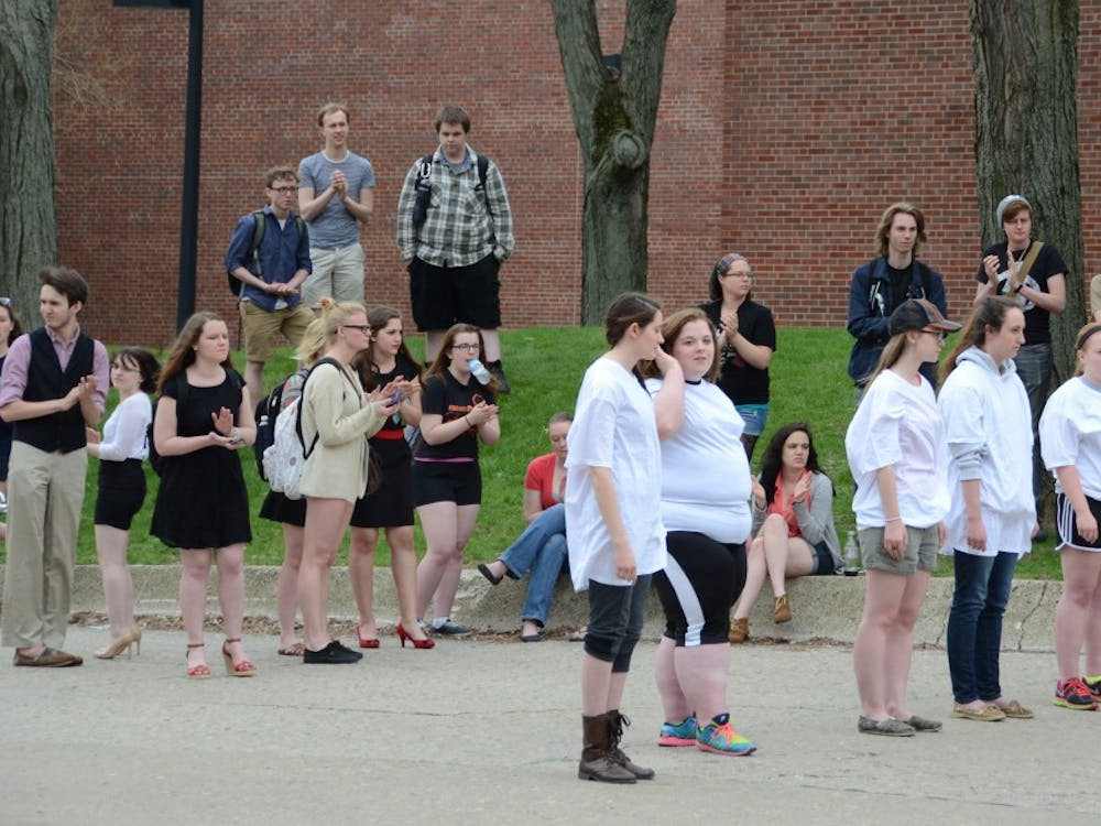 Students lined up to represent the failure of justice for minorities.