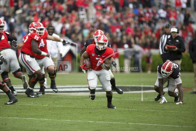 Georgia running back D'Andre Swift (7) runs the ball in the first half of the NCAA football spring G-Day game at the University of Georgia in Athens, Ga., on Saturday, April 20, 2019. (Jenn Finch/Athens Banner-Herald via AP)