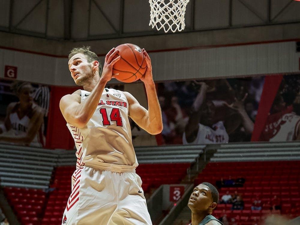 Senior forward, Kyle Mallers (14), grabs a rebound during the second half against the defense on Nov. 5, 2019, at John E. Worthen Arena. Mallers ended the game with seven total rebounds for the Cardinals win 87-43. Omari Smith, DN