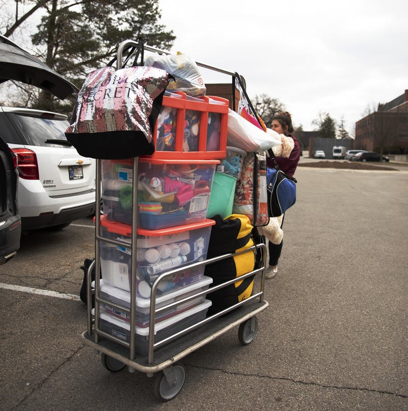 Exercise science senior Danielle Sprouse moves out of her dorm March 18, 2020, outside of Park Hall. Students were told on March 16 the dorms would be closing by 5 p.m. March 29. Jacob Musselman, DN