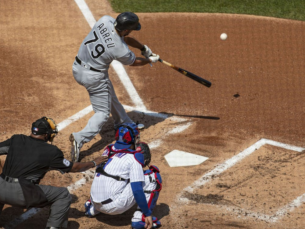 Jose Abreu of the Chicago White Sox connects on a home run off Chicago Cubs starting pitcher Yu Darvish in the second inning on Sunday, August 23, 2020, at Wrigley Field in Chicago. TNS, Photo Courtesy