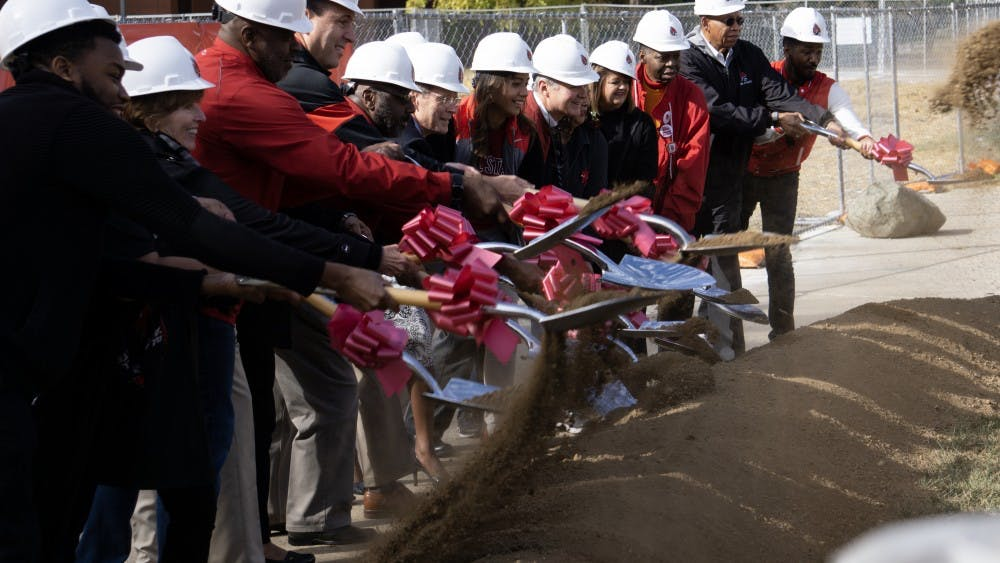 President Mearns, the Board of Trustees and several guests break ground on the new Multicultural Center. The new center, which will be finished in about a year, will a 10,000 square foot facility located to the east of Bracken Library. John Lynch, DN.