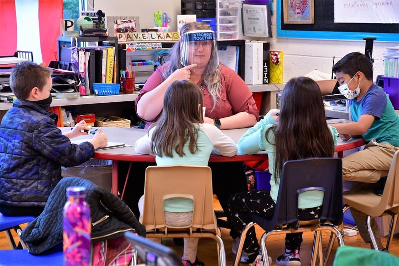 Kelsey Pavelka reads with students in her class April 16, 2021, in West View Elementary School. Pavelka is a teacher in the Dual Language Immersion Program, which teaches students Spanish and English simultaneously to foster early language development. Andy Klotz, Photo Provided