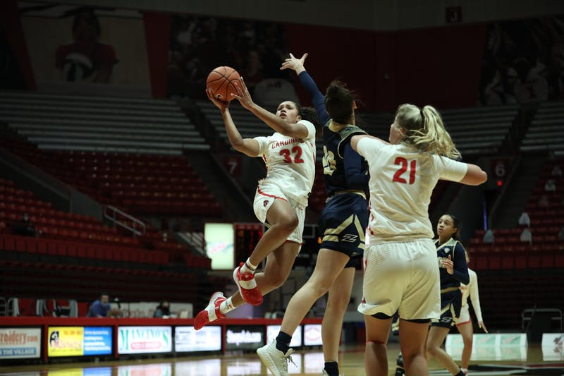 Cardinals senior forward Oshlynn Brown jumps to the rim Feb. 6, 2021, at John E. Worthen Arena. The Cardinals lost 89-84 to the Zips. Jacob Musselman, DN