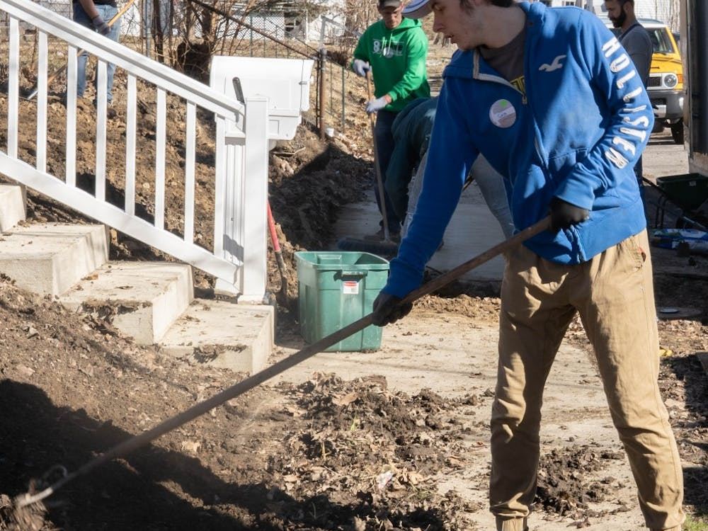 A volunteer plows dirt at a Habitat for Humanity house Mar. 23, 2019 during the CCIM Community day. Volunteers had the opportunity to help out in a morning shift, afternoon shift or both.  Scott Fleener, DN