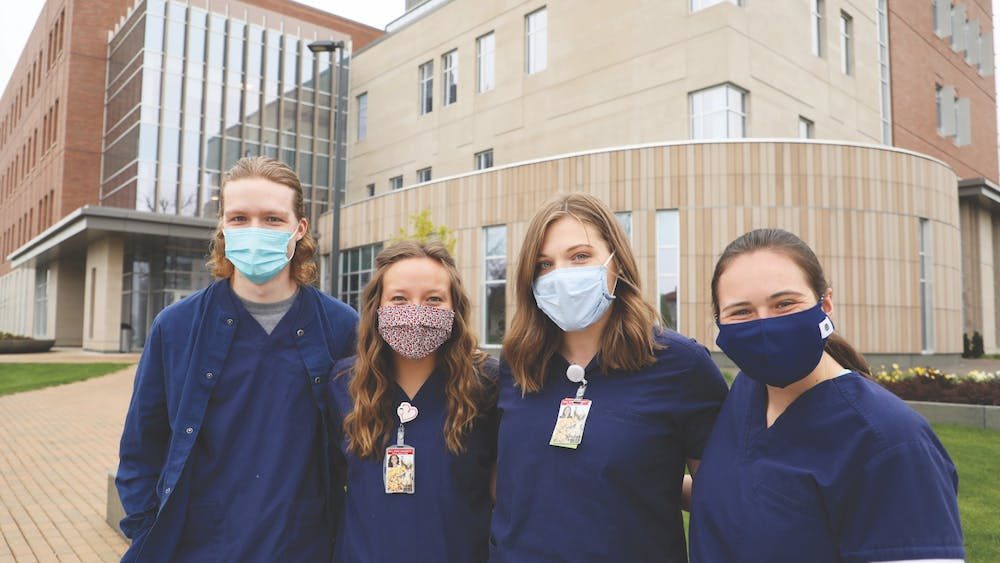 (from left to right) Senior nursing majors Gabriel Cochard, Lauren Hamil, Emily Bastian and Kaitlyn Hansen pose for a photo outside of the Health Professions Building. The building opened in 2019 and houses the university's College of Health. Rylan Capper, DN