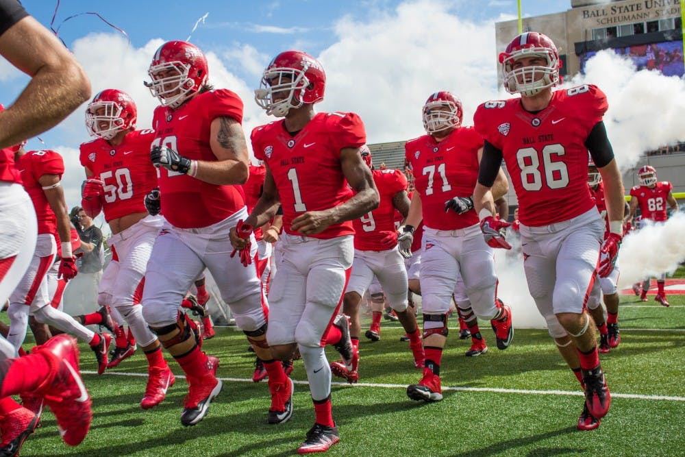 <p>The Ball State Cardinals run onto the field at the beginning of the home opener game against Eastern Kentucky on Sept. 17 in Scheumann Stadium. Ball State heads to Illinois Saturday looking for its eighth consecutive season-opening victory. Grace Ramey, DN</p>