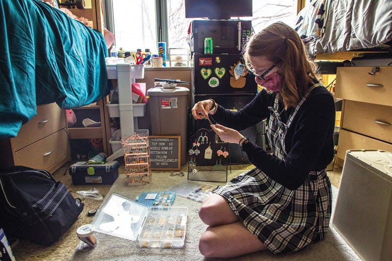 Freshman psychology major Maiya Garcia assembles an earring for her jewelry business, Maiya Makes Jewelry, April 9, 2021 in her dorm room at DeHority Complex. Out of all the pieces of jewelry she makes, Garcia sells earrings the most. Nicole Thomas, DN