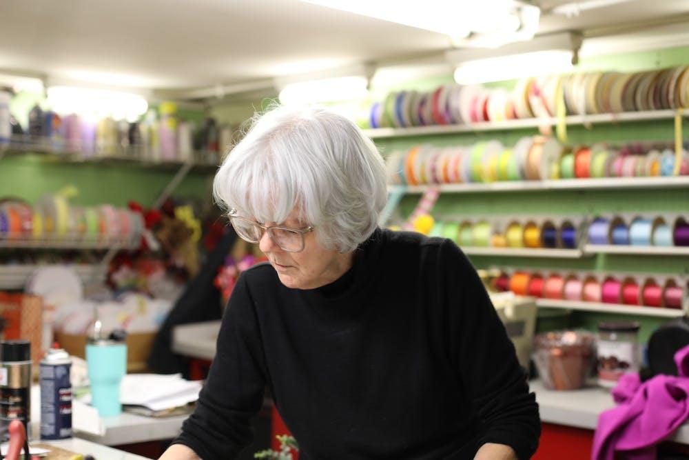 <p>Judy Benken works on an arrangement Jan. 28, 2020, at Normandy Flowers. Benken is a third-generation florist that has been at Normandy Flower Shop since 1982. <strong>Pauleina Brunnemer, DN</strong></p>