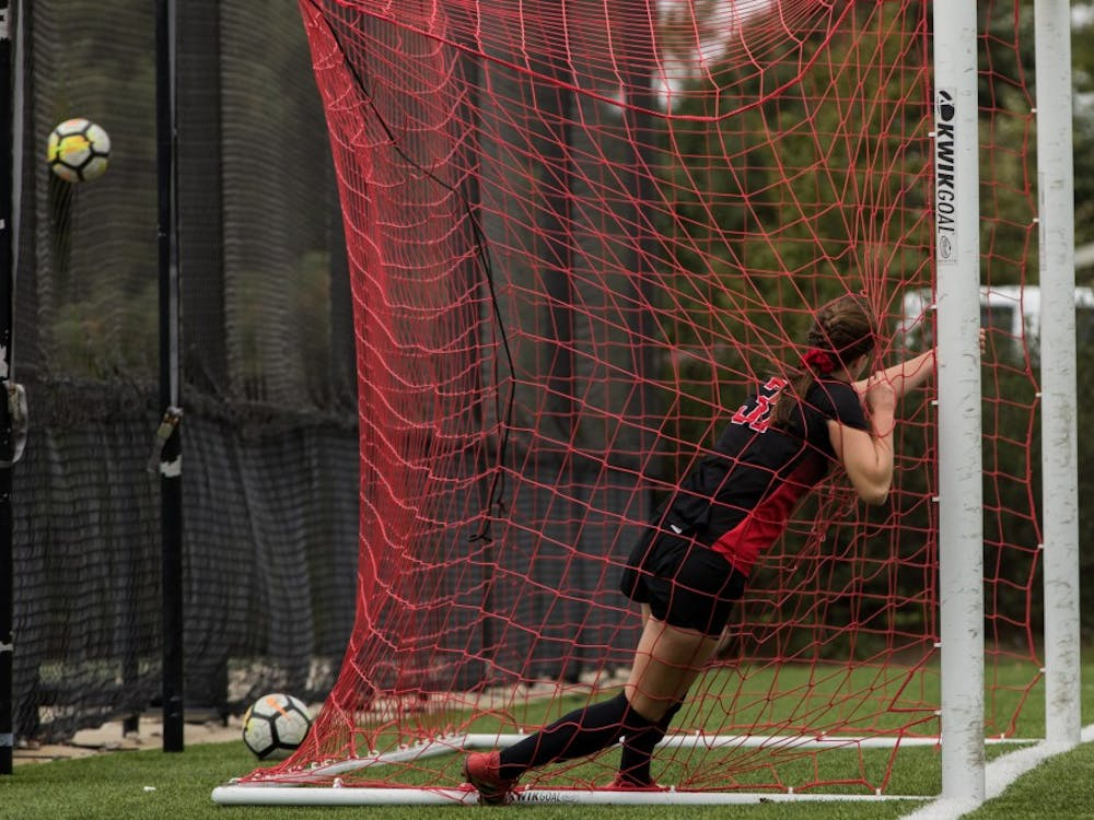 Midfielder/forward Tatiana Mason grabs the goal to stop herself from running through it after missing a goal Oct. 14, 2018, at Briner Sports Complex. Ball State showed up to work in the second half of their game against the University at Buffalo, but couldn't make a goal to expand their lead ending with a 1-0 victory. Eric Pritchett,DN