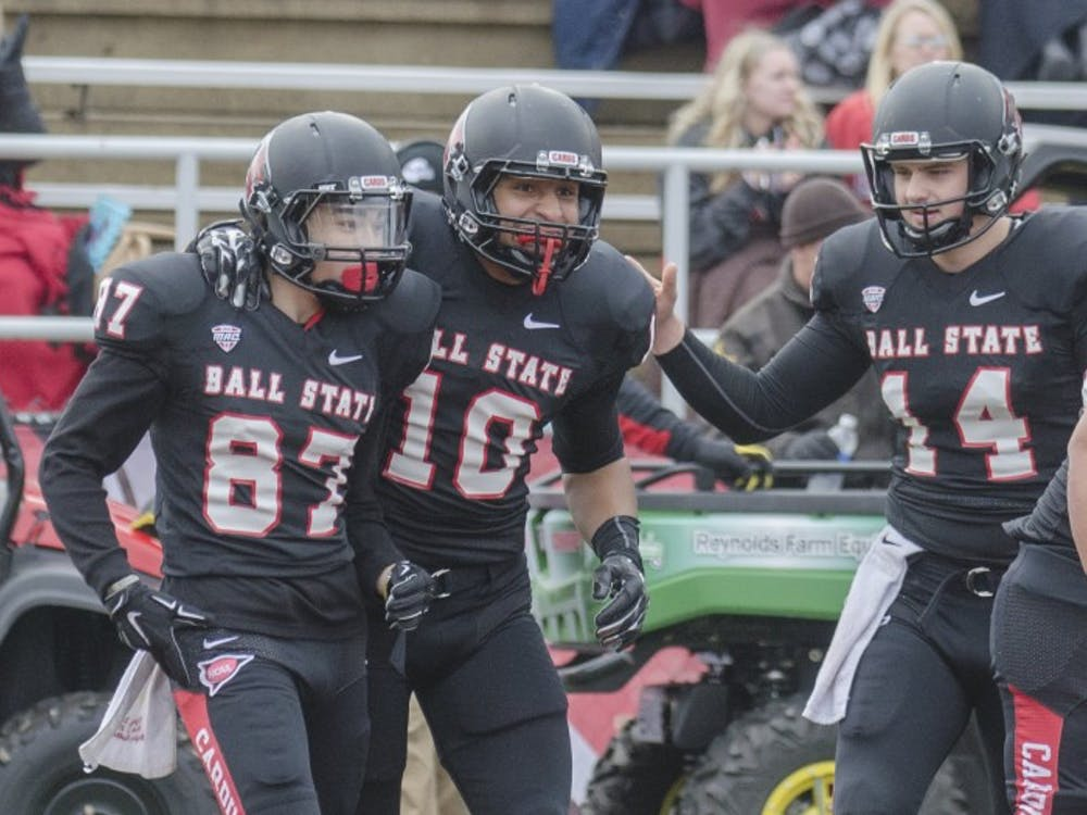 Members of the Ball State football team celebrate after freshman wide receiver Corey Lacanaria scored a touchdown during the game against Eastern Michigan on Nov. 22 at Scheumann Stadium. DN PHOTO BREANNA DAUGHERTY