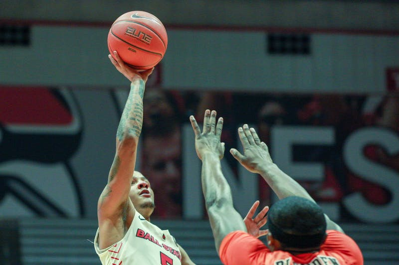 Junior guard, Ishmael El-Amin (5), attempts a teardrop layup against Bowling Green, Feb. 15, 2020, at John E. Worthen Arena. The cardinals made a run at the end of the game but it wasn't enough as they fall to the Falcons 77-71. Omari Smith, DN