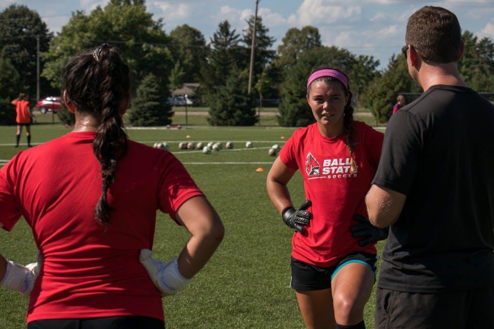 Goalkeeper Alex Deruvo and Tristin Stuteville talk with assistant coach Steve Shelton during practice Wednesday Sept. 5, 2018 at Briner Sports Complex. Eric Pritchett, DN