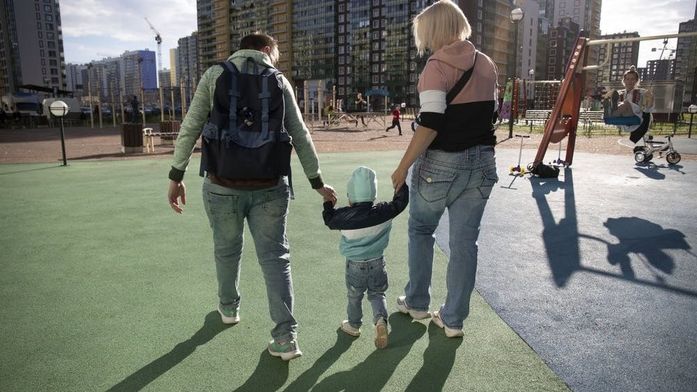 Irina and Anastasia Lagutenko walk with their son, Dorian, at a playground July 2, 2020, in St. Petersburg, Russia. Their 2017 wedding wasn't legally recognized in Russia. (AP Photo)