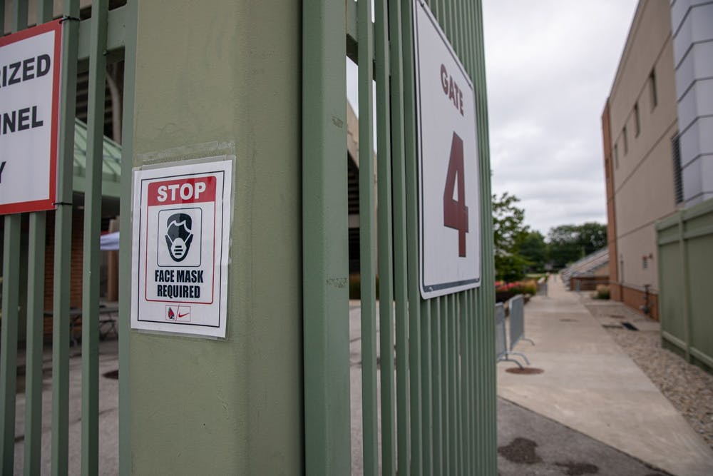 <p>A sign reminds people entering to wear face masks Sept. 1, 2020, outside of Scheumann Stadium. The Mid American Conference was the first to cancel its college football season.<strong> Jacob Musselman, DN</strong></p>