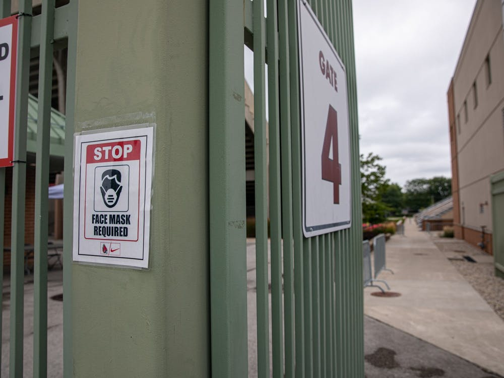 A sign reminds people entering to wear face masks Sept. 1, 2020, outside of Scheumann Stadium. The Mid American Conference was the first to cancel its college football season. Jacob Musselman, DN