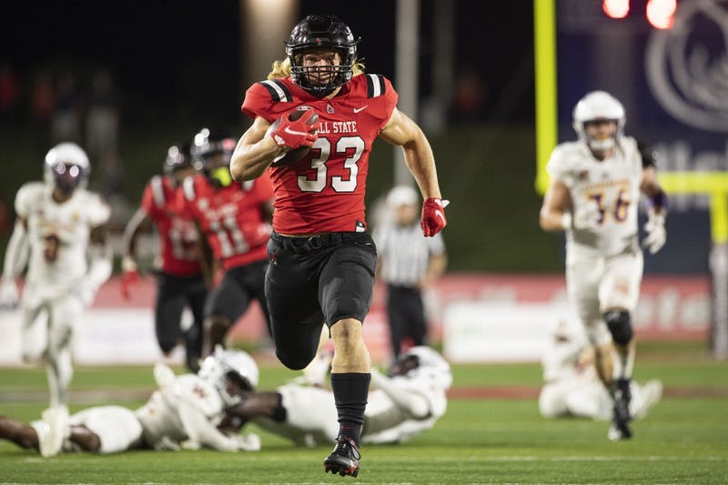 Cardinals freshman running back Carson Steele runs for his first collegiate touchdown against the Western Illinois Roughnecks Sept. 2, 2021, at Scheumann Stadium. The Cardinals beat Western Illinois in the home opener 31-21. Jacob Musselman, DN