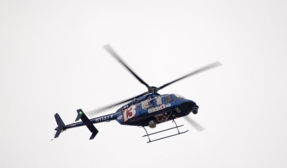 Television helicopters circle around the area as police secure the Student Recreation and Wellness Center after a report of an armed assailant in the building. DN PHOTO COREY OHLENKAMP
