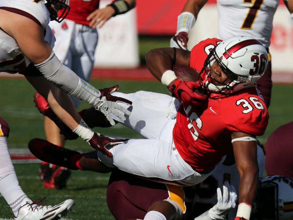 Freshman running back Caleb Huntley falls to the ground during the Cardinals' game against Central Michigan on Oct. 21 at Scheumann Stadium. Huntley had 81 rushing yards for gain. Paige Grider, DN