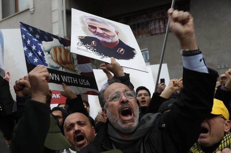 """Protesters chant anti-U.S. slogans during a demonstration against the killing of Iranian Revolutionary Guard Gen. Qassem Soleimani, close to United States' consulate in Istanbul, Jan. 5, 2020. Iran has vowed """"harsh retaliation"""" for the U.S. airstrike near Baghdad's airport that killed Soleimani, as tensions soar in the wake of the targeted killing. (AP Photo/Lefteris Pitarakis)"""