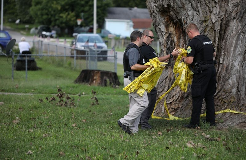 Muncie Police Department officers take down police lines after a shooting at the intersection of Hartford and Princeton Street Friday, Aug. 23, 2019. Rebecca Slezak, DN