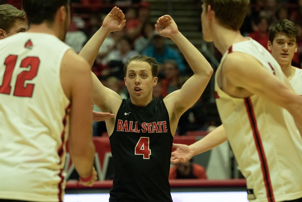 <p>Senior libero Nick Lavanchy celebrates with his team after a win Jan. 10, 2020, in John E. Worthen Arena. Ball State beat Queens, 3-0. <strong>Jacob Musselman, DN</strong></p>