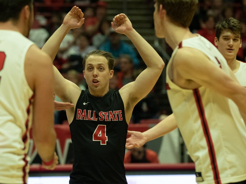 Senior libero Nick Lavanchy celebrates with his team after a win Jan. 10, 2020, in John E. Worthen Arena. Ball State beat Queens, 3-0. Jacob Musselman, DN